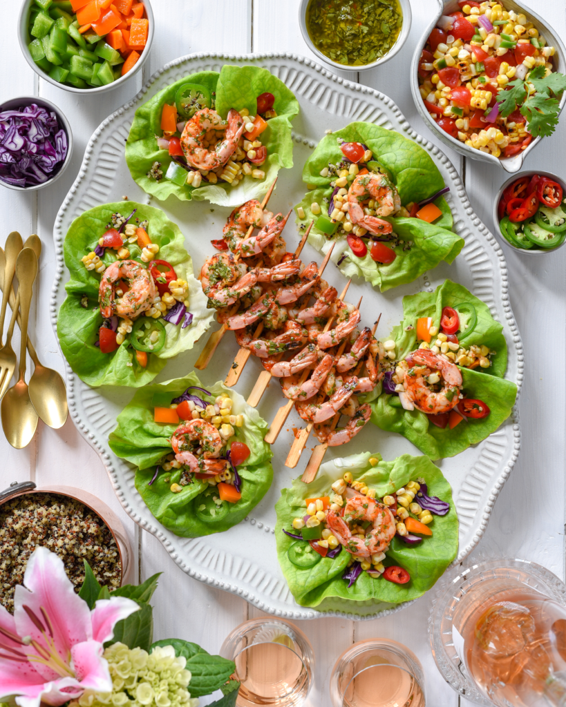 This picture show how you can plate the shrimp skewers and lettuce wraps.