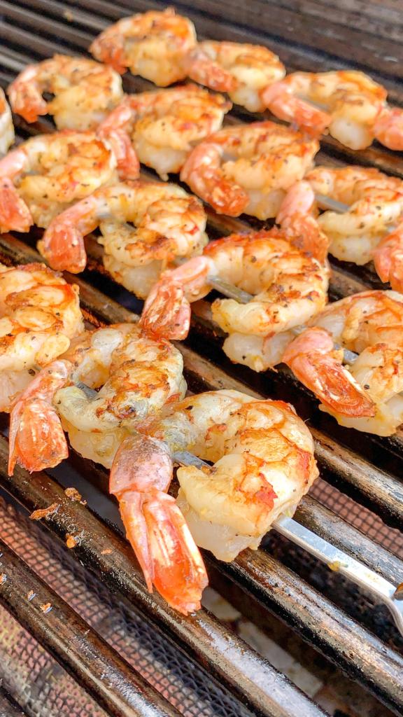 Skewered shrimp on a grill.