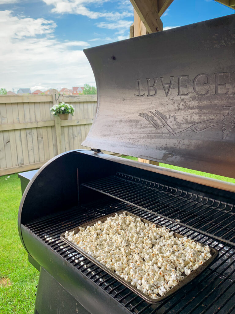 Traeger grill with a sheetpan of popcorn.